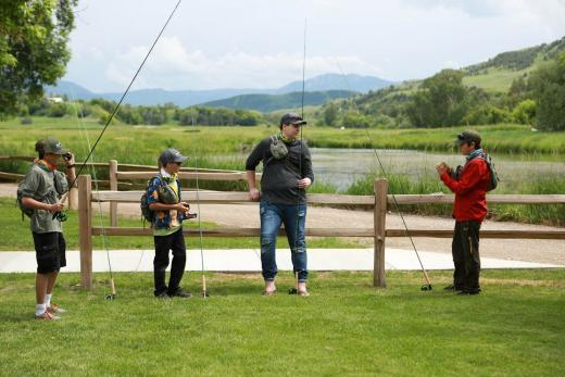 Young boys fly fishing in Utah